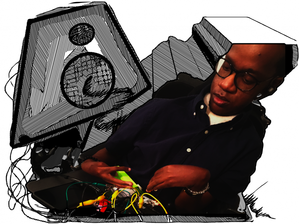 Gift Tshuma, a black man in his late twenties, sits in front of a table of cables and crocodile clips. In the background the cables run into a cartoon-like speaker.